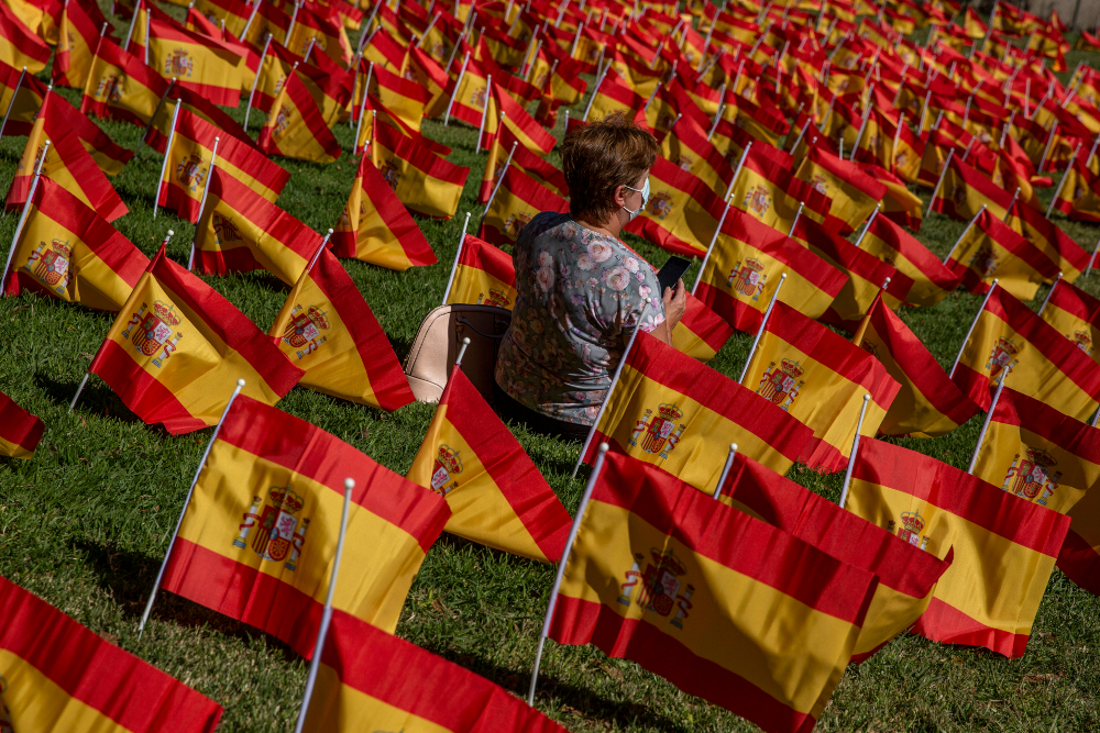 AP - Madrid - Coronavirus - Spain - Flags